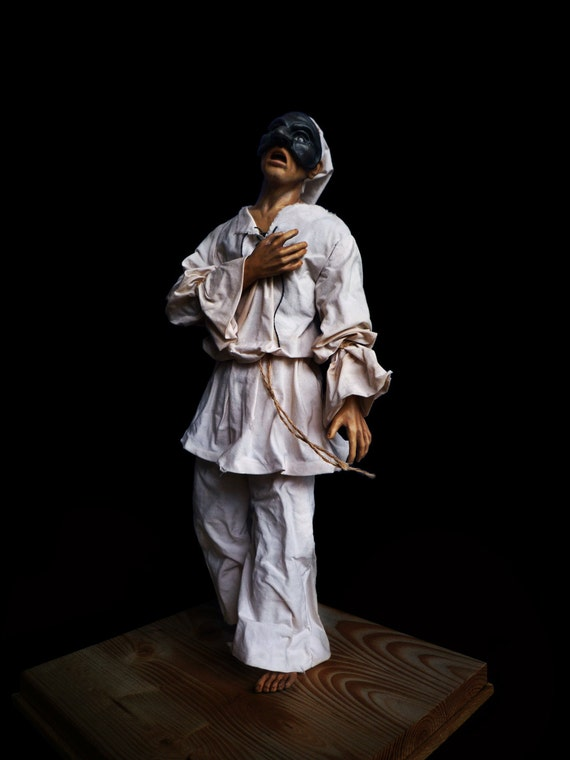 Mixed media sculpture (clay, fabric, wood).Traditional italian character - Pulcinella
