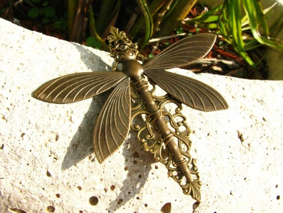 A Dragonfly in Flight Filigree Brooch Pin by bajunajewelry on Etsy from etsy.com