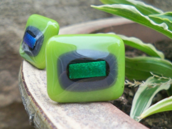 The glass in these cufflinks was fused, by myself in my small Yorkshire Studio.