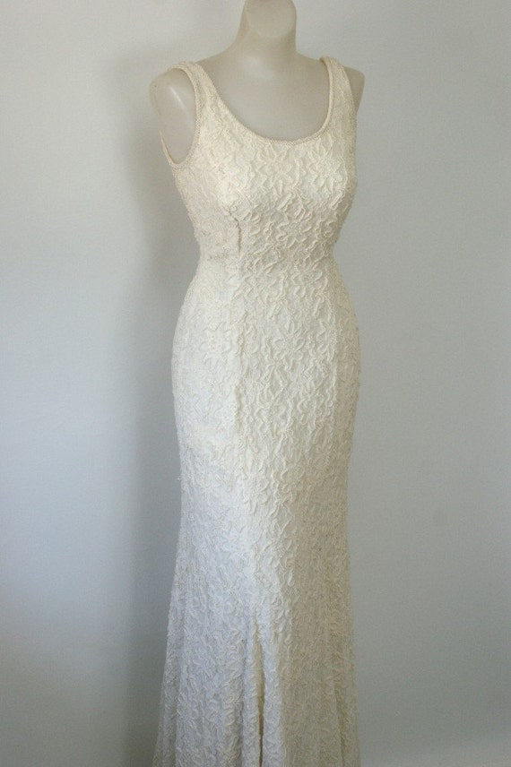the carmen marc valvo pearl gown.