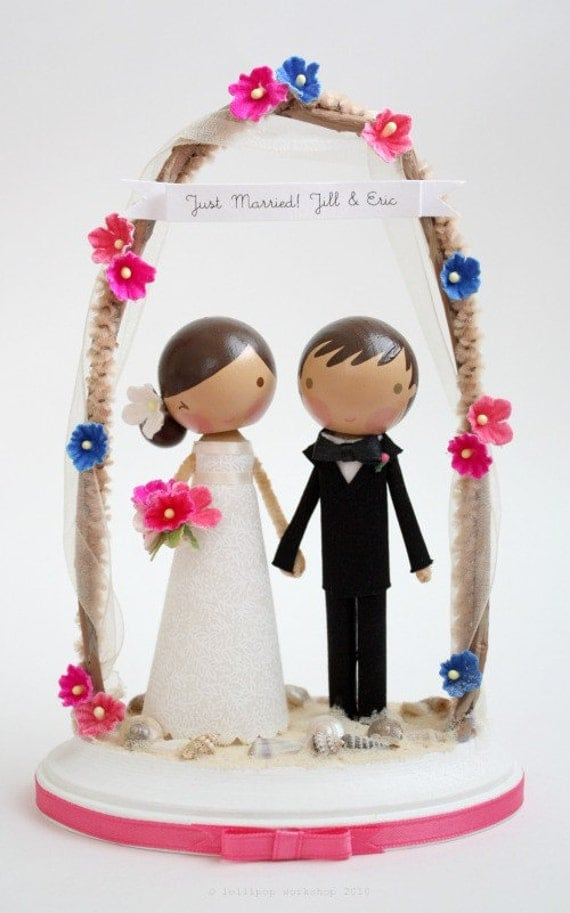 custom beach wedding cake topper with arch From lollipopworkshop