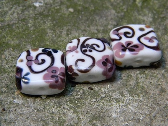 These Swirly and Flowery Tiles were created by me using white, violet and slightly reducing purple glass