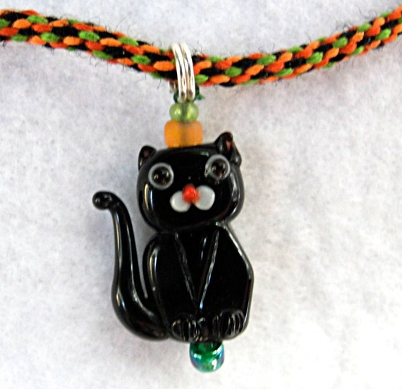 Kitty necklace black orange and green