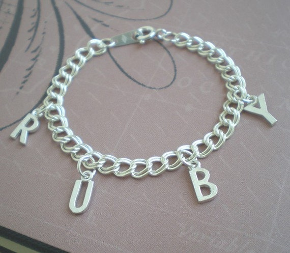 Lovely Sterling Silver bracelet for girl's spelling out their name with four letter charms or 3 letters and an open hear