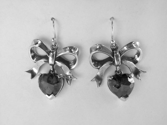 Sterling Silver Bow Earrings with Hanging Heart Stone