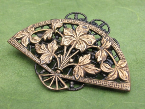 Brass Filigree Fan Brooch with Flowers by bajunajewelry on Etsy from etsy.com