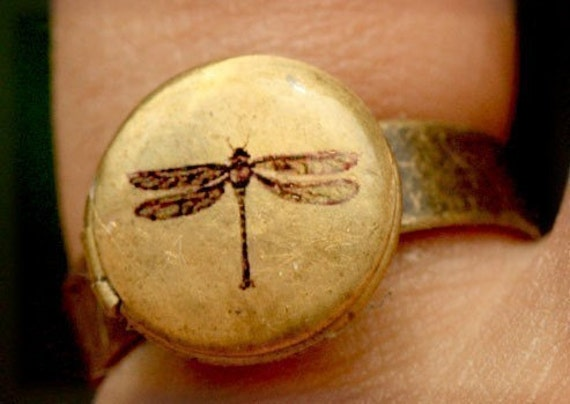 Locket ring is vintage brass adjustable with dragonfly drawing by