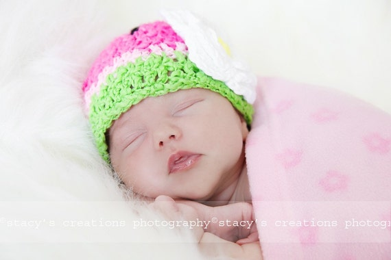 Cute watermelon hat with crocheted flower. Sizes 0-12 month.