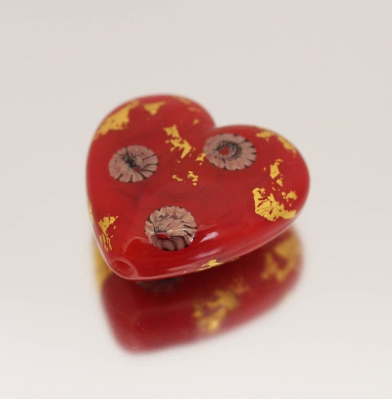 This lovely focal heart bead coordinates with the Geisha set. A stunning shade of scarlet red, decorated with white, red and black murrini and gold foil.