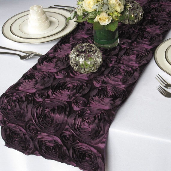 A stunning and unique dark purple rosette table runner.