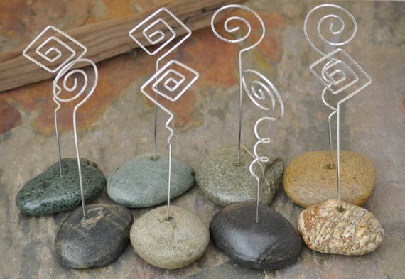 A fun mix of naturally formed beach rocks set with aluminum wire place card holders