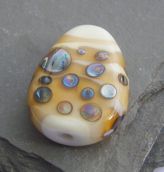 With a white base, this slab focal lampwork bead with bands of amber/topaz wrapped around it and those silver mirror spots from the land of Double Helix and beautiful colours lying deep within, taking you into the unknown!!!