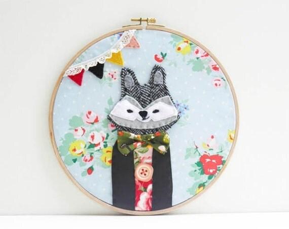 Luis the raccoon embroidery hoop
