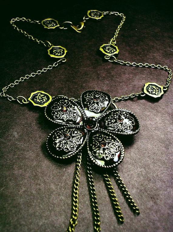 Vintage inspired gem studded flower pendant and brooch.