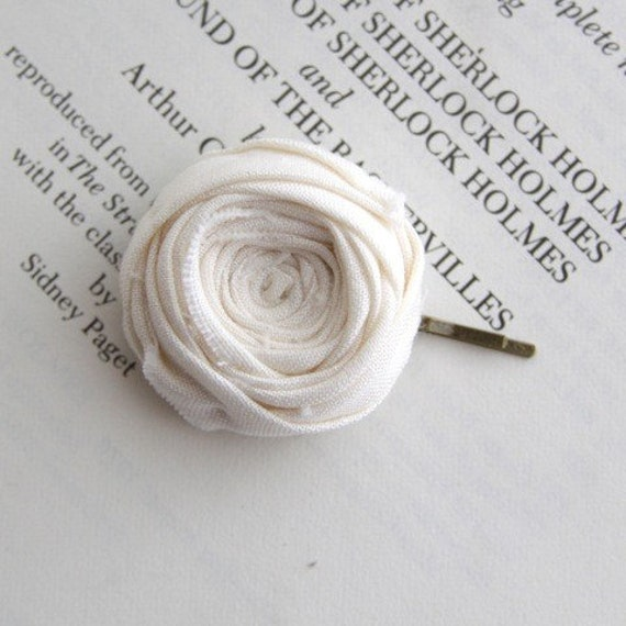 Cute white rosette bobby pin.
