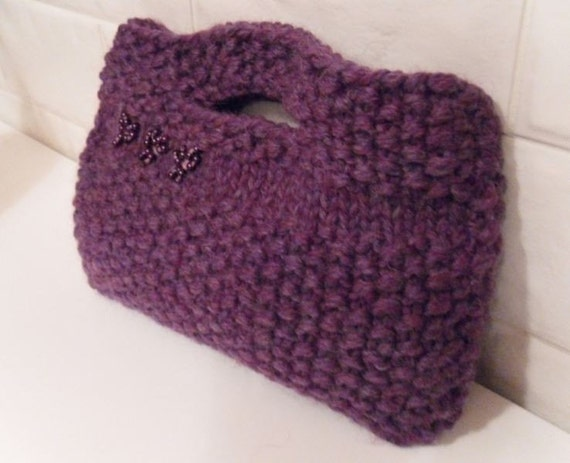 Hand knitted 100% woollen moss stitch purple clutch bag , felt lined.