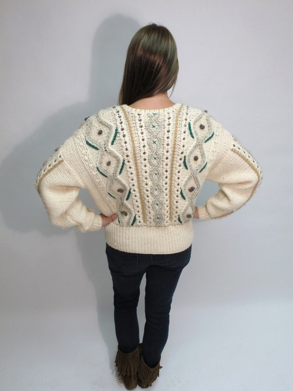 The Chunky 1980s Cable Knit Cardigan.