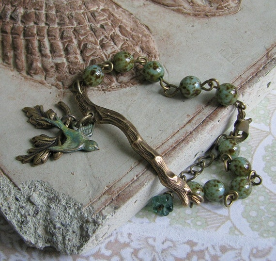 FREE SHIPPING - Bluebird Bracelet - Vintage and nature inspired, antiqued brass branch with verdigris bird, leaf and brown speckled aqua blue glass beads