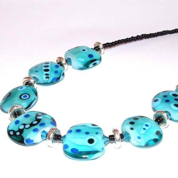 This necklace is made with lampwork beads made by me in my home studio.