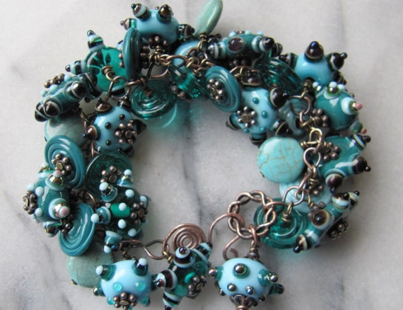 This bracelet contains loads of my handmade lampwork beads and discs, as well as a few pieces of turquoise for good measure.