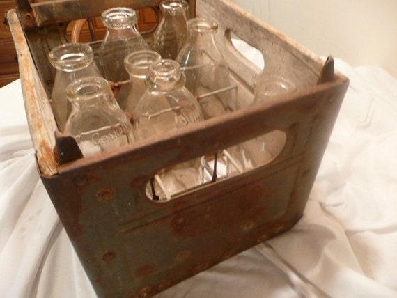 8 Milk Jugs in Crate