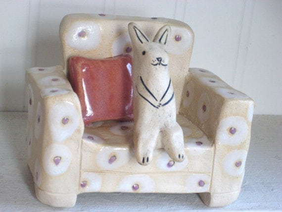 Cute Rabbit Sitting on Spotted Chair Ceramic Sculpture