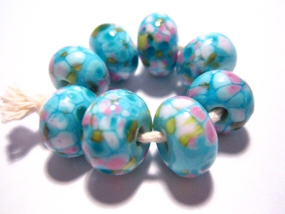 8 really pretty and shamelessly girly beads made by me, Rachel B, in my home studio in Cornwall.