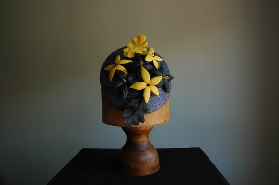 Sinamay headpiece with handmade leather flowers in black and yellow