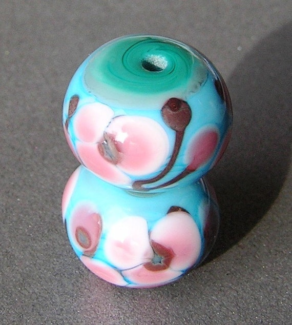 A pair of turquoise and green Lampwork beads with my Cherry Blossom design, suitable for earrings.