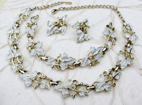 Sarah Coventry Plain and Fancy Demi Parure by BajunaJewelryVintage from etsy.com