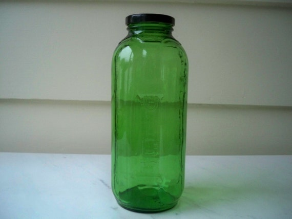 Emerald green glass juice/water bottle with black metal lid