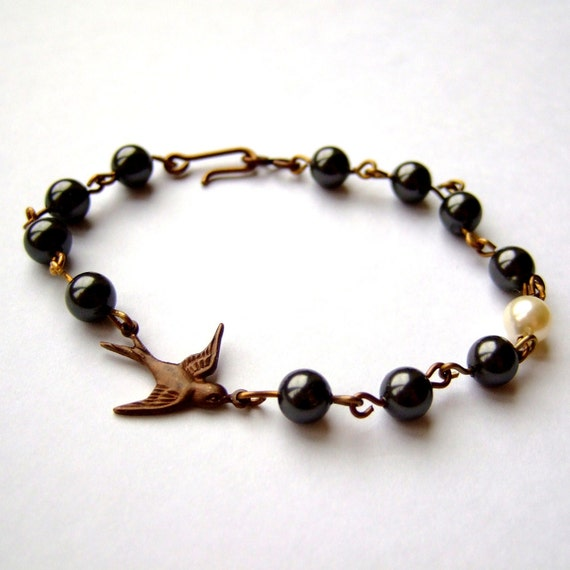 "Brass swallow and Swarovski pearl bracelet - ""Fly Me To The Moon"""