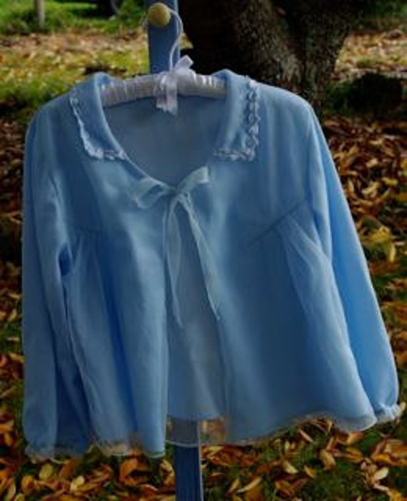 Pale blue vintage bed jacket