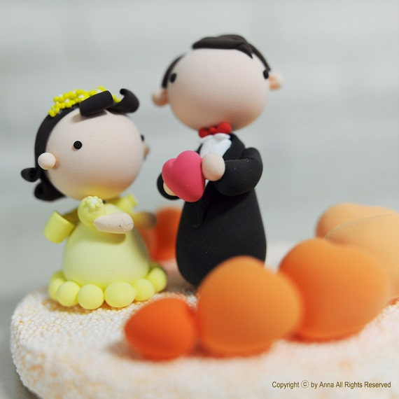 Cute and adorable theme wedding cake topper with heart pool