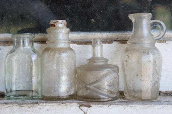 Four Vintage Bottles  Vintage glass