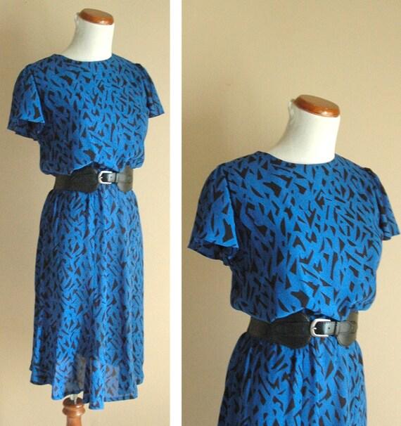 Vintage 1980s flirty black and blue secretary dress