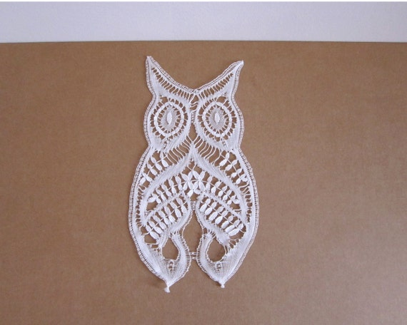 The owl of luck. Figure of bobbin lace from Spain