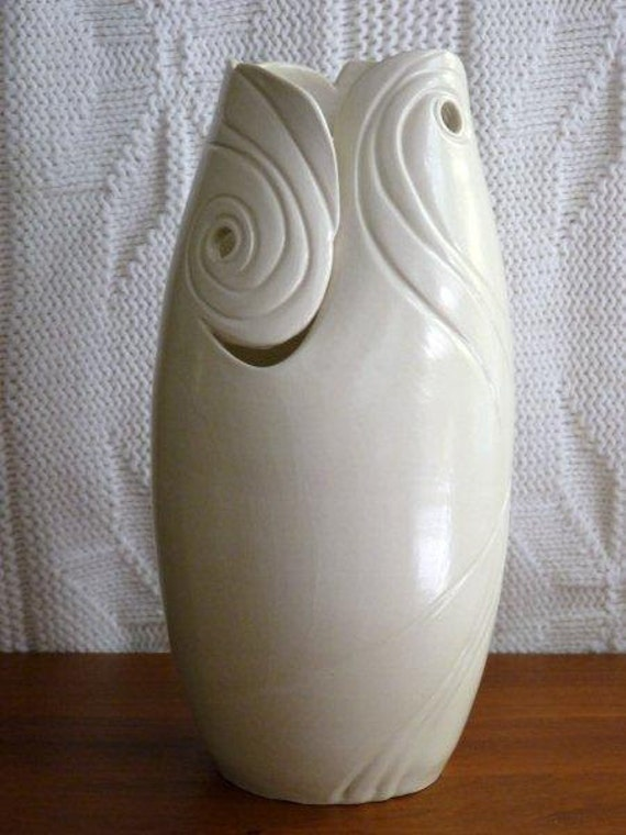 Series: circa 1920. Hand crafted and carved one of a kind porcelain vase.