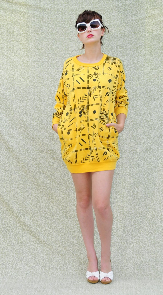 1980's Vintage yellow sweatshirt dress with black geometric pattern and front pockets