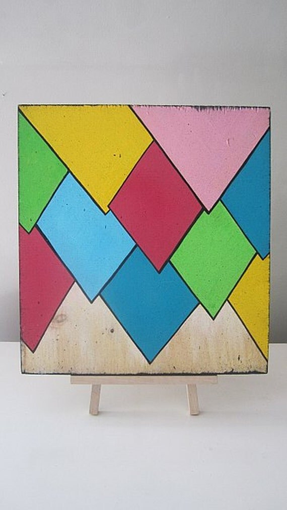 Multi-Colored cartoon points on a 12x14in repurposed piece of softwood