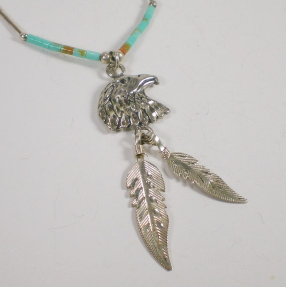 Vintage Sterling Eagle Feathers And Turquoise Pendant by paleorama from etsy.com