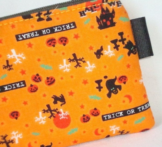 Halloween Cemetery Ghosts Zippered Pouch  Orange by WolfBait from etsy.com