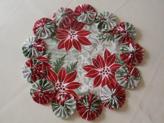 Poinsettia Christmas Yo Yo Mat candles plants vases penny rug style family home decor