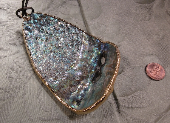 This is a Calfornia abalone shell pendant with gold bezel