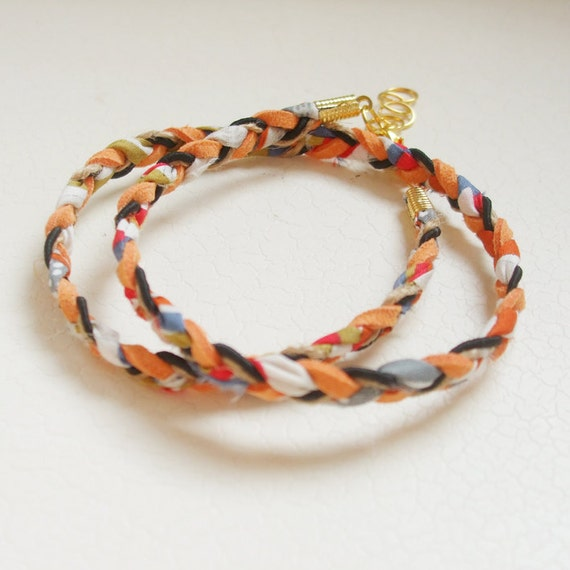 BRACELET // orange and black braid wrap