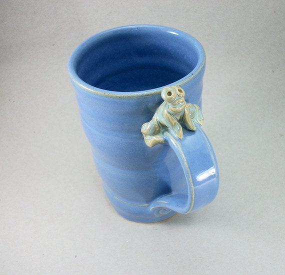 large blue mug with a frog