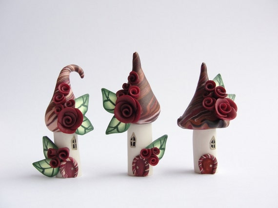 Miniature tropical fairy village in deep red and brown handmade from polymer clay