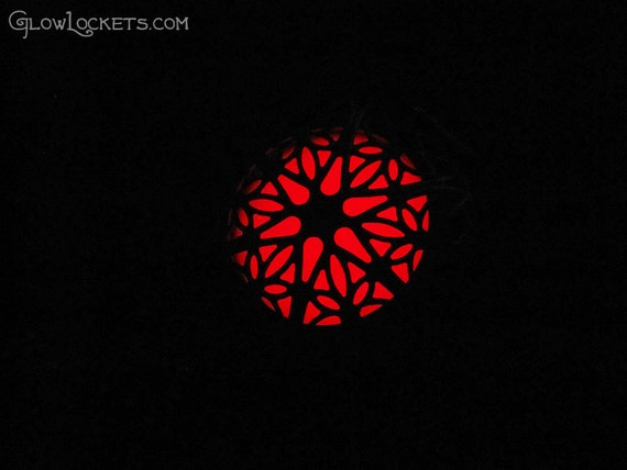 red fire glow in the dark locket