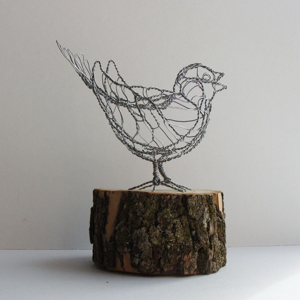 wire sculpture made from useless junk the design work