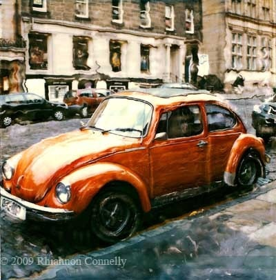 little orange volkswagen beetle